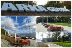 Napis Arka Gdynia, drewniana ławka w kształcie fali, trawnik i ścieżka // fot.ZDiZ